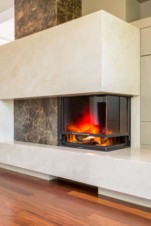 fireplace living room: Shot of a concrete fireplace in a modern living room