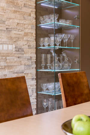 display case: Shot of a dining room with a display case full of glasses