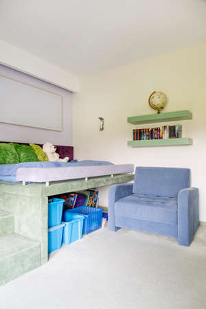 teen bedroom: Shot of a cozy teen bedroom with a comfortable armchair Stock Photo