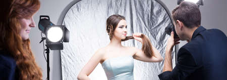 advertising agency: Attractive photo model during professional session for advertising agency, panorama Stock Photo
