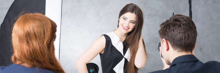 advertising agency: Attractive fashion model during professional photo session for advertising agency Stock Photo