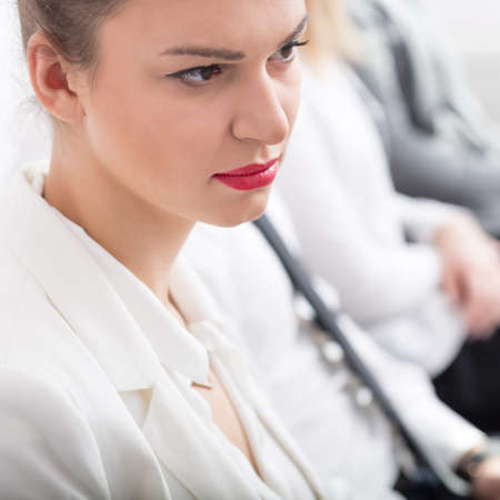 Corporations: Beauty young businesswoman with red lips - square Stock Photo