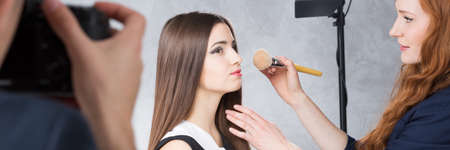 visagiste: Makeup artist, beautiful model and photographer during commercial photo session, panorama