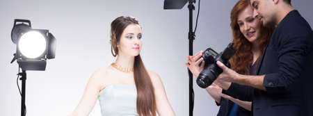 visagiste: Young and beautiful model, floor manager and photographer during commercial photo session, panorama Stock Photo