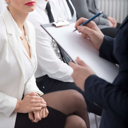 women legs: Squared picture of job interview in the office Stock Photo