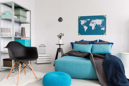 pouffe: Light bedroom with blue bedding and pouffe, new, simple furniture