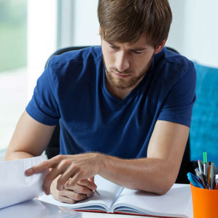 transcribe: Attractive student during his work for classroom