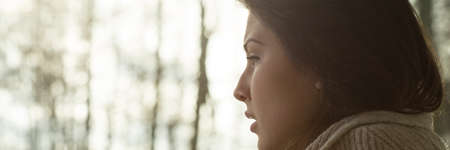 health professional: Close-up of young depressed crying woman sitting alone
