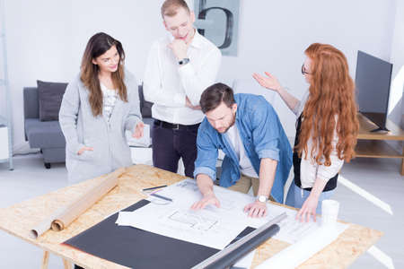bard: Young co-workers are leaning over a drawing bard Stock Photo