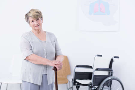 walking stick: Shot of an elderly woman using a walking stick