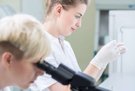 well equipped: Women scientist working in well equipped modern laboratory