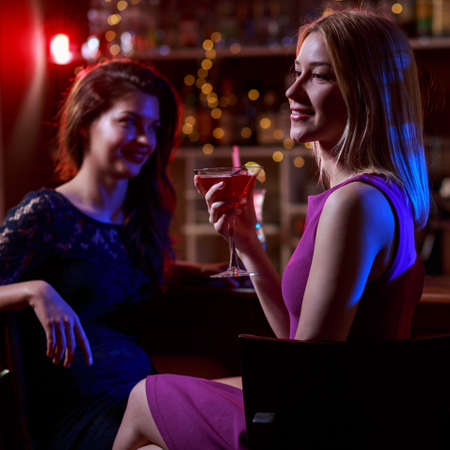 after work: Girls relaxing in night club after work
