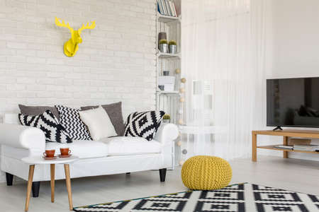 comfort room: Shot of a cozy creative room with yellow accessories