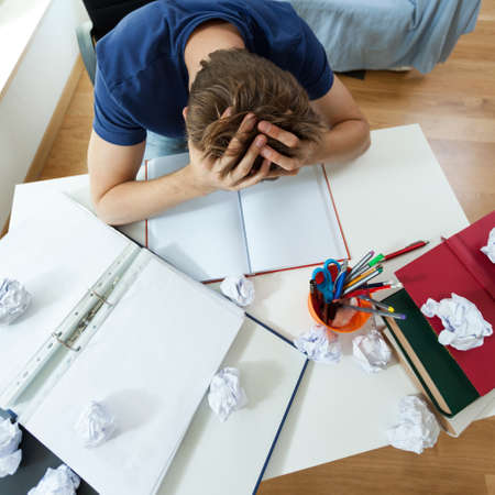 frustrated student: Top view of a frustrated student before examination Stock Photo
