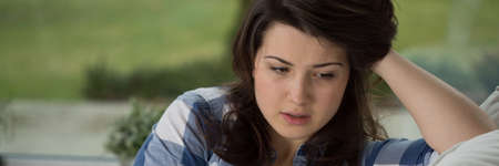 individual: Depressed teenager talk with psychologist about her problems