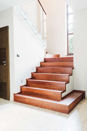 wood door: Shot of a modern wooden staircase in a house