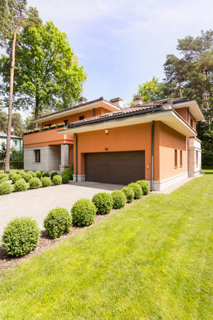 Shot of a modern detached house surrounded by trees