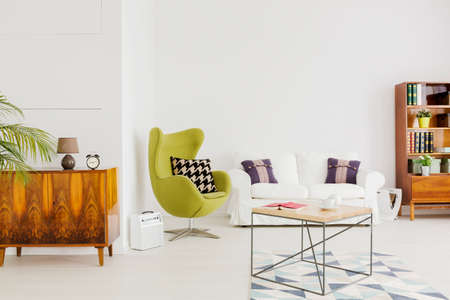 coffee table: Contemporary very bright apartment with renovated set of furniture and a green egg chair