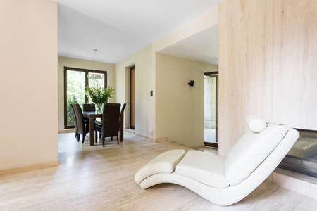 comfort room: Shot of an armchair in a modern room