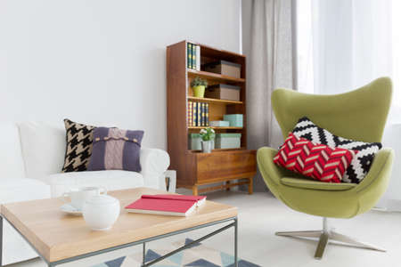 modern chair: Close-up of a modern coffee table in a very bright contemporary room