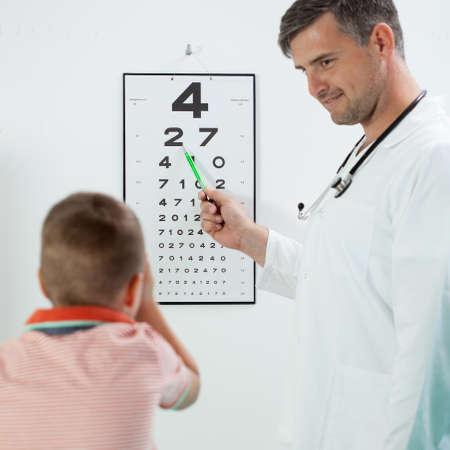 pediatrist: Pediatrist make to his patient eye test