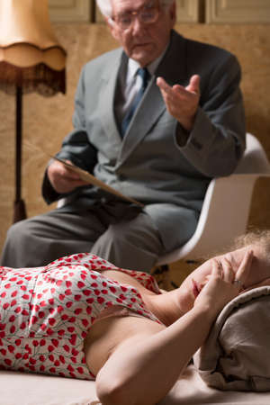 psychoanalysis: Senior therapist tries to explain something to his depressed patient
