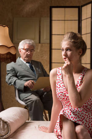 psychoanalysis: Thoughtful young woman is sitting on the couch during psychoanalysis