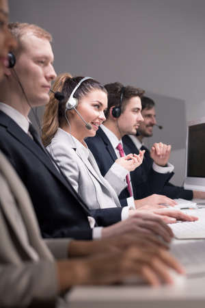 professionalist: Consultants are focusing in their everyday duties connected with work on computers and telephone sets  Stock Photo