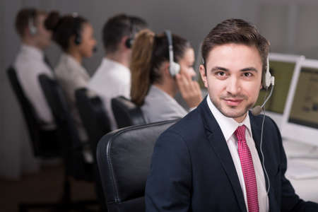 professionalist: Young male consultant looks straight to the camera with confidence
