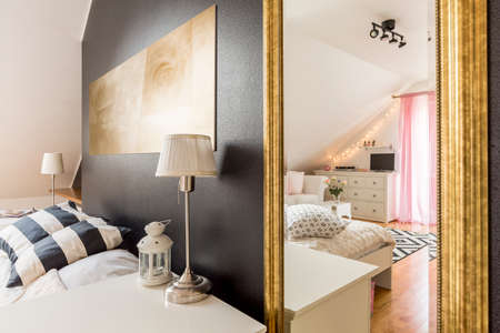 bedroom furniture: New bedroom with glitter black wall open to a spacious, light bedroom with white furniture