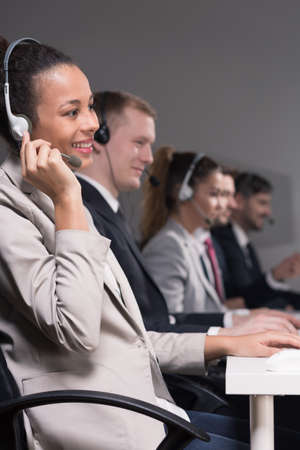 professionalist: Call center employees during talking with a clients