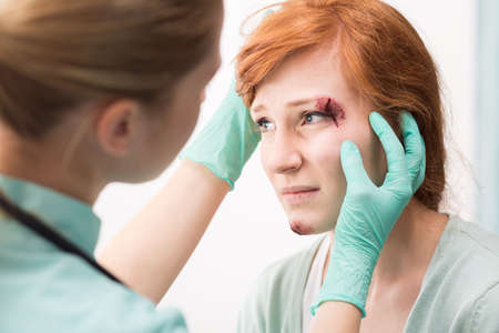Shot of a young woman having her face examined by a doctor Reklamní fotografie
