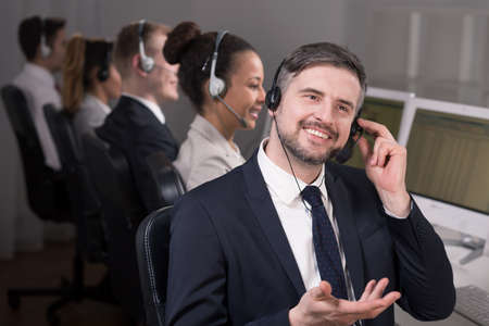 professionalist: Male consultant explains something to the customer by phone
