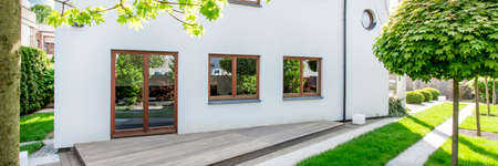 Panoramic picture of a modern detached house Stock Photo