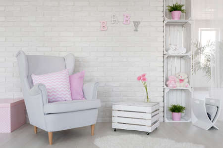 room wall: Fragment of a baby room with a white brick wall and DIY furniture made of wooden boxes