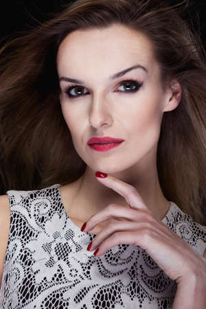 femme fatale: Close-up portrait of a very beautiful and elegant woman in strong makeup Stock Photo