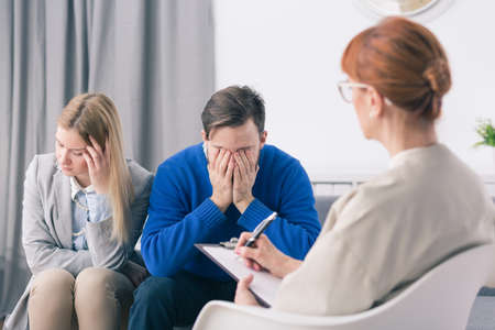 devastated: During marital therapy husband and wife are devastated and sad