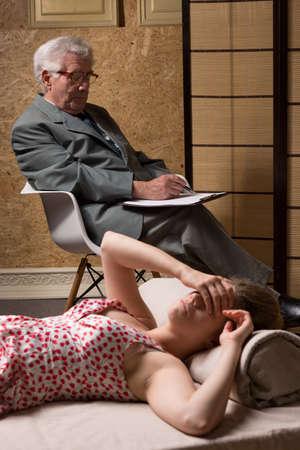 psychoanalysis: Devastated woman covers her eyes during psychoanalysis