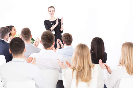 employer: Happy proud employer applauding and thanking to her companys team for a hard good job Stock Photo