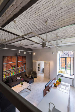 mezzanine: Image of a two floor home interior with industrial brick roof Stock Photo