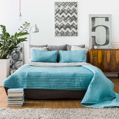 bedspread: Turquoise bedspread on marital bed in cozy bedroom