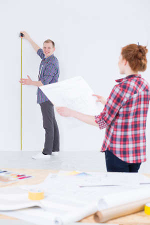 redecorate: Shot of a young couple renovating their flat
