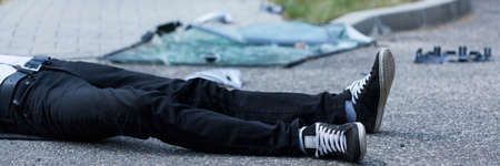 dissociation: Man lying on the street after car accident
