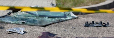 fatality: Horizontal view of serious car accident with victim