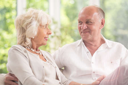 into: Happy elderly couple gazing into each others eyes