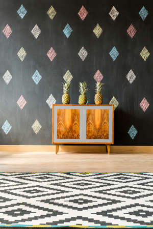 commode: Modern interior with blackboard, pattern carpet and exotic style commode Stock Photo