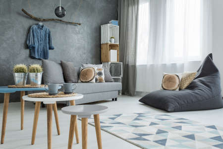 bean bag: New flat interior with decorative wall effect, small table, two chairs, sofa and bean bag