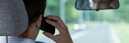 driving car: Man talking on phone during driving car