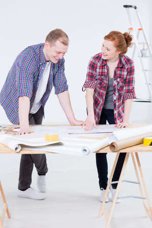 redecoration: Shot of a happy couple planning their flat design Stock Photo