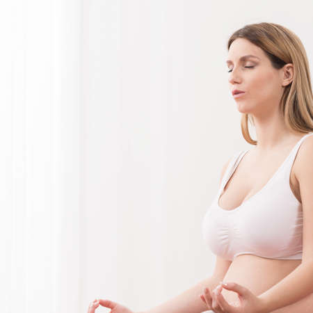 pregnant underwear: Vertical view of yoga breathing in pregnancy Stock Photo